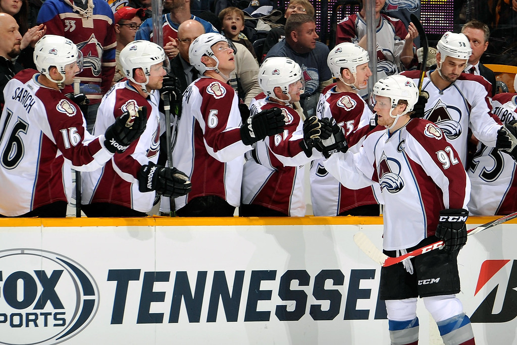 . Gabriel Landeskog #92 of the Colorado Avalanche is congratulated by teammates after scoring a goal against the Nashville Predators at Bridgestone Arena on March 25, 2014 in Nashville, Tennessee.  (Photo by Frederick Breedon/Getty Images)