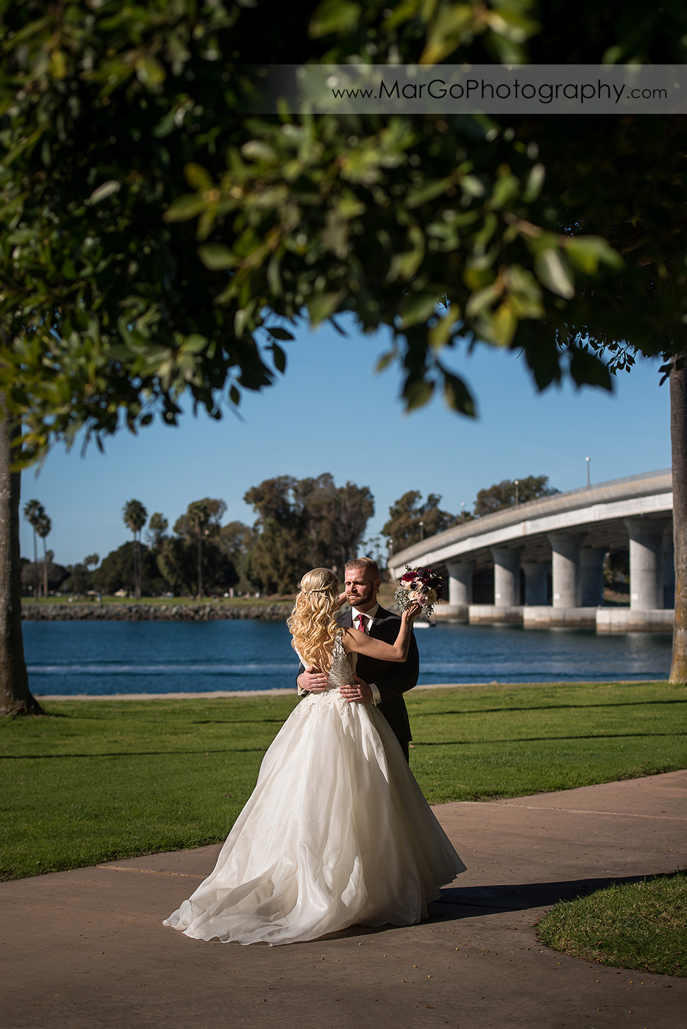 bride and groom looking at each other during first look at San Diego Mission Bay Park