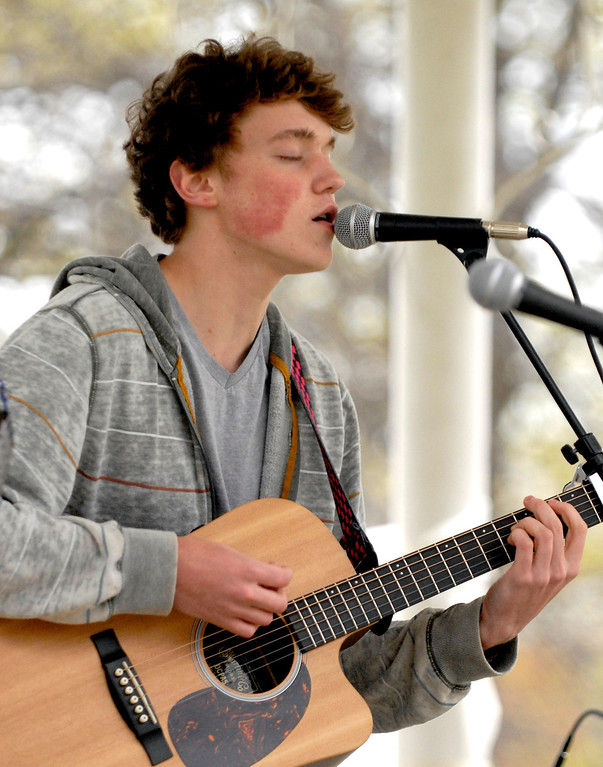 . Jeff Forman/JForman@News-Herald.com Rob Huffman, 16, sings and plays guitar with other musicians from the Leory Community Chapel during a National Day of Prayer observance May 1 in Painesville.
