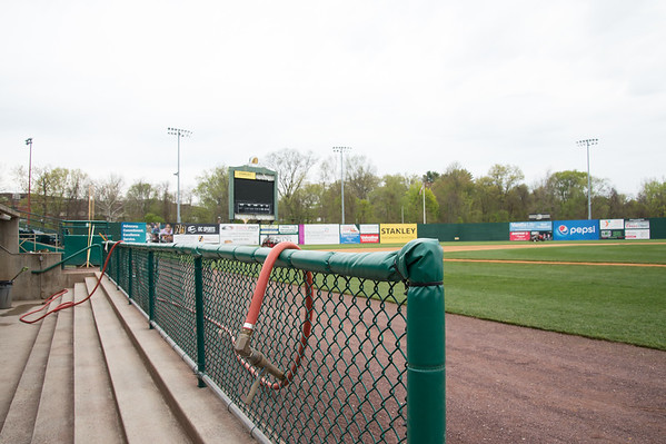 05/02/19 Wesley Bunnell | Staff Work at New Britain Stadium is underway getting the field in shape for Friday's upcoming New Britain Bees home opener. A water hose which is used to water the infield area is draped across the visitors dugout.