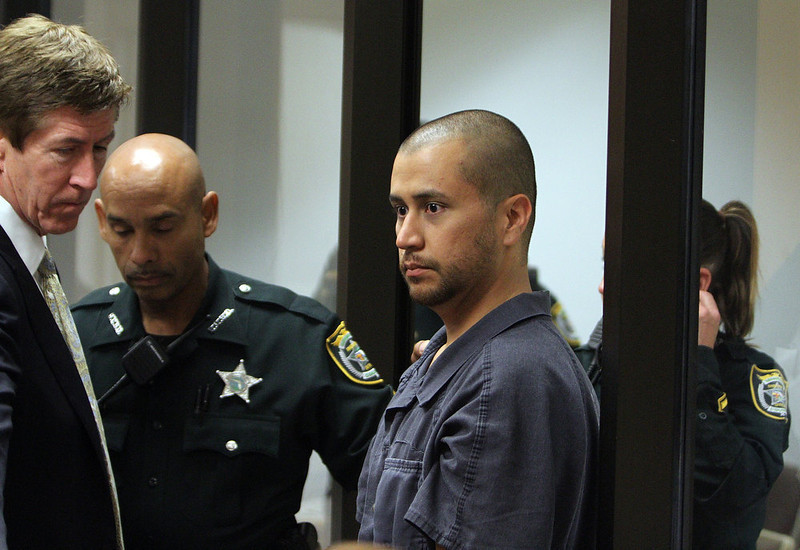 ". George Zimmerman appears for a bond hearing with his attorney Mark O\'Mara (L) at the John E. Polk Correctional Facility April 12, 2012 in Sanford, Florida. Zimmerman was charged yesterday with second degree murder in the fatal shooting of 17-year-old Trayvon Martin who died February 26, 2012. ""Trayvon Martin shooting\"" ranked as Google\'s ninth most searched trending event of 2012. (Photo by Gary Green/The Orlando Sentinel-Pool/Getty Images)"