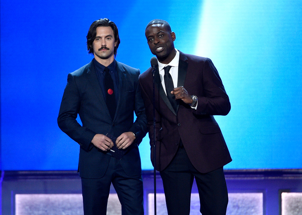 . Milo Ventimiglia, left, and Sterling K. Brown present the award for best actor in a movie made for television or limited series at the 22nd annual Critics\' Choice Awards at the Barker Hangar on Sunday, Dec. 11, 2016, in Santa Monica, Calif. (Photo by Chris Pizzello/Invision/AP)