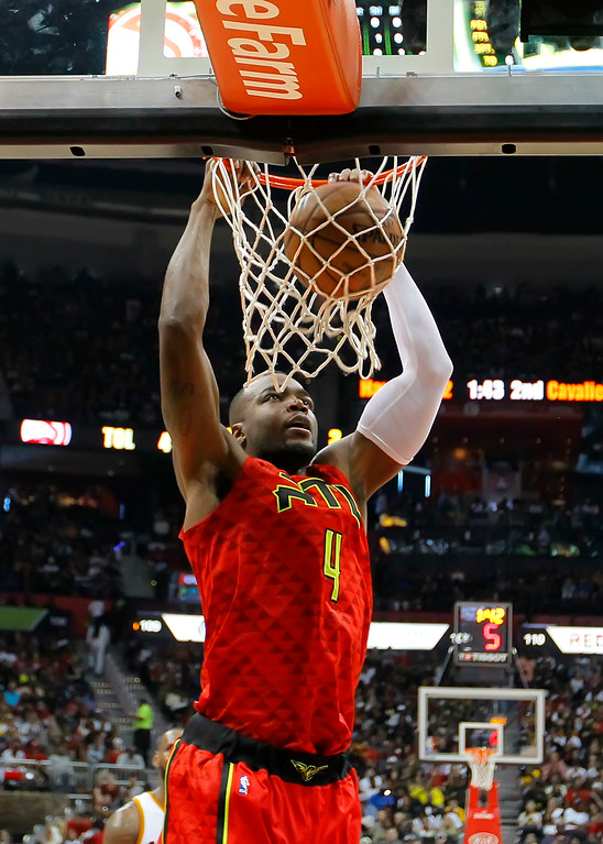 . Atlanta Hawks forward Paul Millsap (4) slams in the first half of an NBA basketball game against the Cleveland Cavaliers on Sunday, April 9, 2017, in Atlanta. The Hawks won in overtime 126-125. (AP Photo/Todd Kirkland)