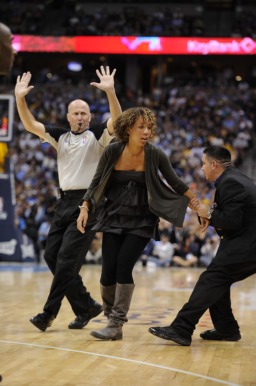 . Play is stopped as a fan runs out onto the court during the second quarter in game 4 of the first round of the NBA playoffs on Sunday, May 6, 2012 at the Pepsi Center in Denver, Colorado. The fan was removed and escorted out of the building. John Leyba, The Denver Post