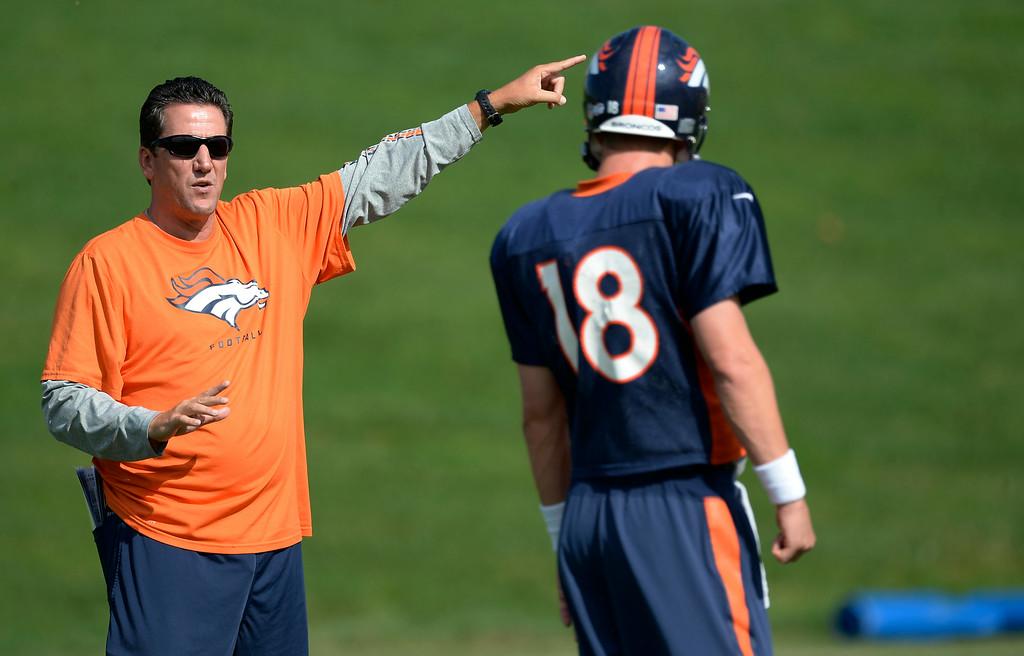. Denver Broncos quarterbacks coach talks with Denver Broncos quarterback Peyton Manning (18) on day 12 of the Denver Broncos 2014 training camp August 5, 2014 at Dove Valley. (Photo by John Leyba/The Denver Post)