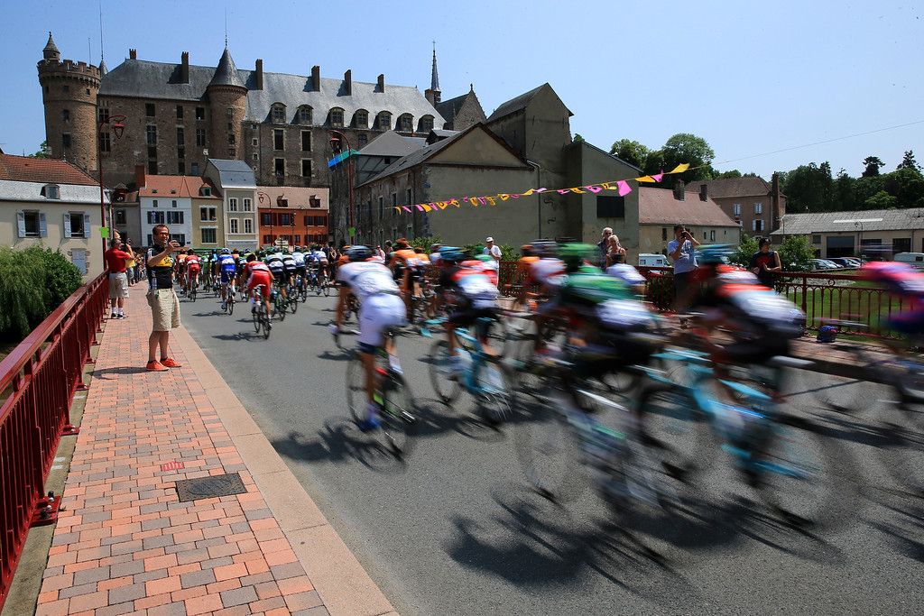 . LYON, FRANCE - JULY 13: A fan photographs the peloton as it passes through a village during stage fourteen of the 2013 Tour de France, a 191KM road stage from Saint-Pourcain-sur-Sioule to Lyon, on July 13, 2013 in Lyon, France.  (Photo by Doug Pensinger/Getty Images)