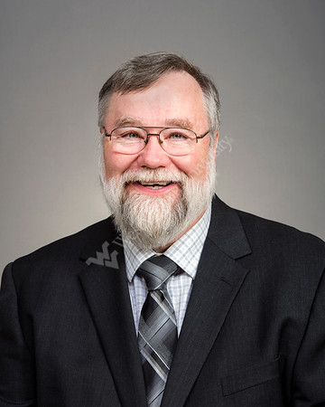 34323 Dr Larry Rhodes  16 x 20  Chair Portrait Pediatrics