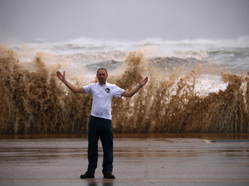 Chase buddy Stu Robinson soaking up the hurricane winds in Galveston before landfall at ground zero. Olympus E3, 50-200mm SWD - F5, 1/500s