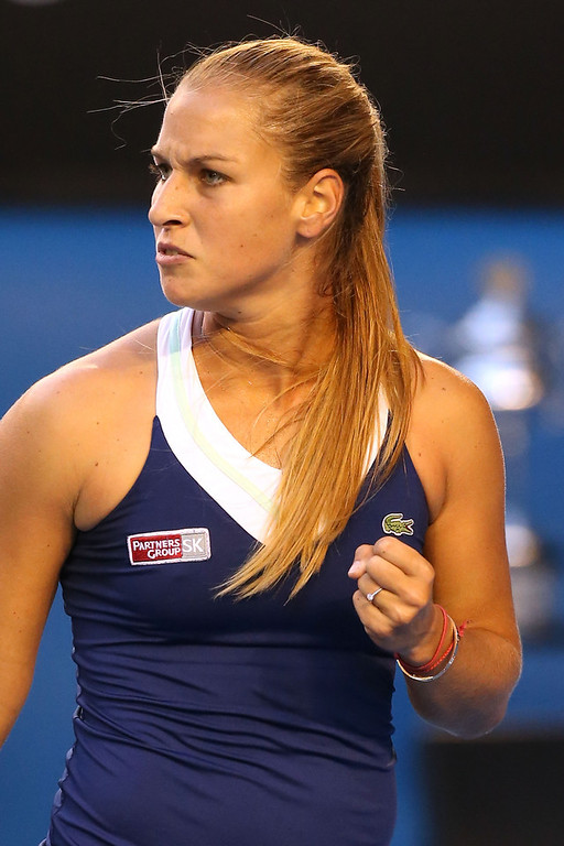 . Dominika Cibulkova of Slovakia celebrates a point in her women\'s final match against Na Li of China during day 13 of the 2014 Australian Open at Melbourne Park on January 25, 2014 in Melbourne, Australia.  (Photo by Michael Dodge/Getty Images)
