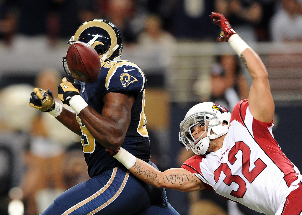. Arizona Cardinals safety Tyrann Mathieu, right, knocks the ball out of the hands of St. Louis Rams tight end Jared Cook after Cook caught a 47-yard pass during the first quarter of an NFL football game on Sunday, Sept. 8, 2013, in St. Louis. Cardinals\' Karlos Dansby recovered the ball in the end zone for a touchback. (AP Photo/L.G. Patterson)