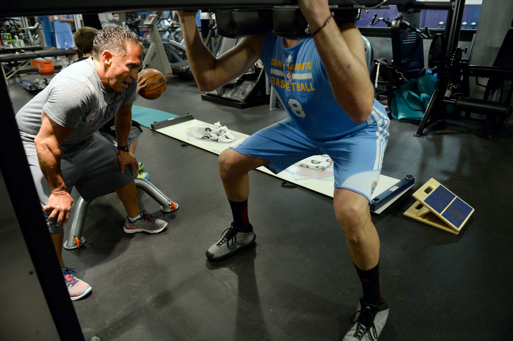 . Denver Nuggets Danilo Gallinari is carefully watched by assistant coach/strength and conditioning Steve Hess (L) May 27, 2014 at Pepsi Center. (Photo by John Leyba/The Denver Post)