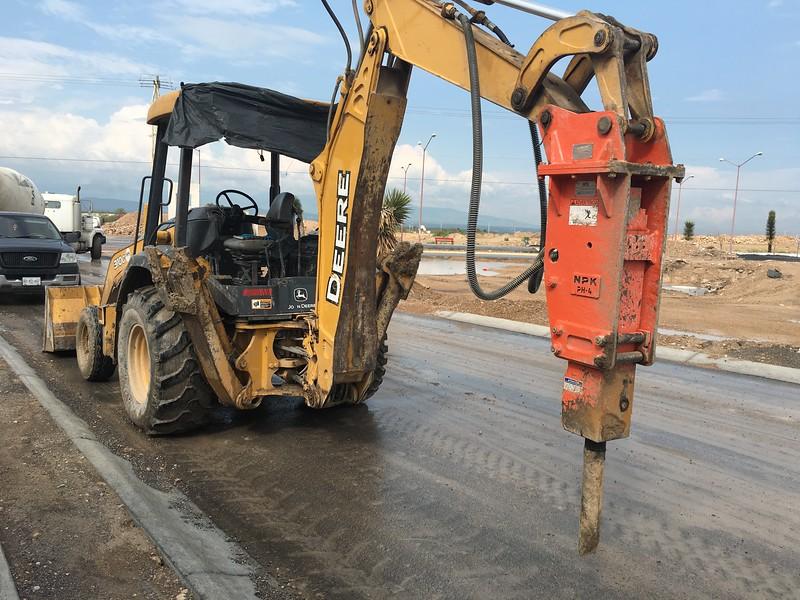 NPK PH4 hydraulic hammer on Deere backhoe in Monterrey Mexico.JPG