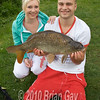 Rob Gardner with a double-figure common carp from Burton Springs Carp La, Somerset. Rob, 20, from Blackbrook, is pictured with girlfriend Phaedra Robbins. © 2010 Brian Gay.