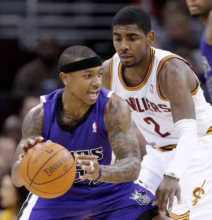 . Sacramento Kings\' Isaiah Thomas, front, tries to get past Cleveland Cavaliers\' Kyrie Irving in the fourth quarter of an NBA basketball game Sunday, Feb. 19, 2012, in Cleveland. Thomas scored a team-high 23 points. The Cavaliers won 93-92. (AP Photo/Tony Dejak)