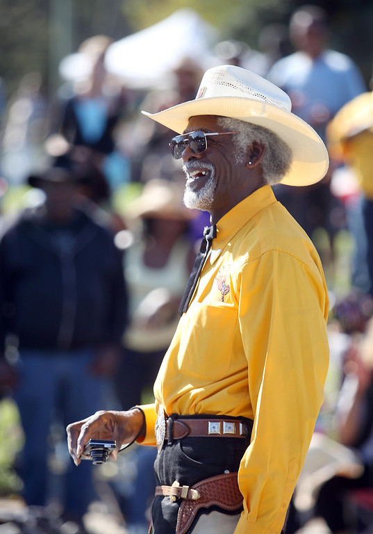 . Oakland Black Cowboy Association president Wilbert McAlister emcees during the 39th annual Oakland Black Cowboy Parade and Heritage Festival in Oakland, Calif., on Saturday, Oct. 5, 2013. The event also featured food, entertainment and pony rides for kids at De Fremery Park. The OBCA began in 1975 and educates the public about the role that black cowboys played in history and building of the west. (Jane Tyska//Bay Area News Group)