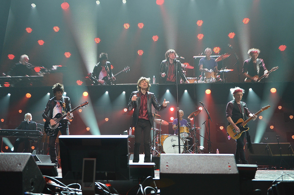 """. Ronnie Wood, Mick Jagger, and Keith Richards of The Rolling Stones perform at \""""12-12-12\"""" a concert benefiting The Robin Hood Relief Fund to aid the victims of Hurricane Sandy presented by Clear Channel Media & Entertainment, The Madison Square Garden Company and The Weinstein Company at Madison Square Garden on December 12, 2012 in New York City.  (Photo by Larry Busacca/Getty Images for Clear Channel)"""