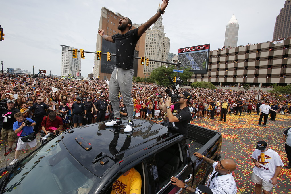 . Cleveland Cavaliers\' Kyrie Irving greets fans  before the start of a parade celebrating the Cleveland Cavaliers\' NBA Championship in downtown Cleveland Wednesday, June 22, 2016. (AP Photo/Gene J. Puskar)