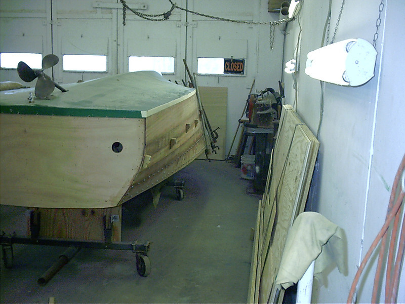 Rear view of last plank on port side glued in place.