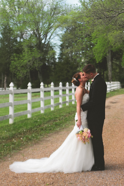 bride and groom kiss at legacy farms nashville