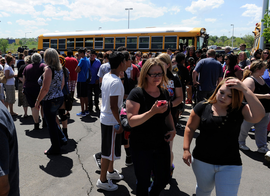 . Parents of Thornton High School students meet their children a few blocks from the school after Thornton police evacuated the school when they received a report of two people with a gun on campus. (Photo By Kathryn Scott Osler/The Denver Post)