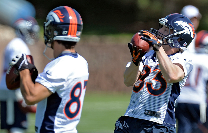 . Wes Welker (83) of the Denver Broncos catches a pass during the teams OTAs May 20, 2013 at Dove Valley. All offseason training activities (OTAs) are voluntary until the mandatory minicamp June 11-13. (Photo By John Leyba/The Denver Post)