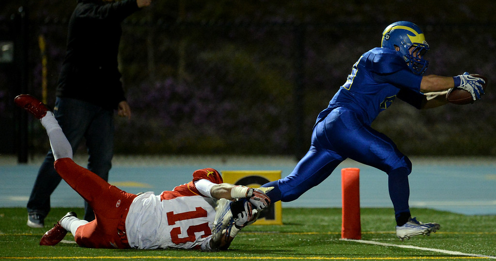 . San Dimas\' Joseph Mayorga (23) runs for the winning touchdown as Paraclete\'s Triston Brown (15) tries to tackle in the fourth quarter of a CIF-SS Mid-Valley Division championship football game at San Dimas High School in San Dimas, Calif., on Friday, Dec. 6, 2013. San Dimas won 20-14.  (Keith Birmingham Pasadena Star-News)