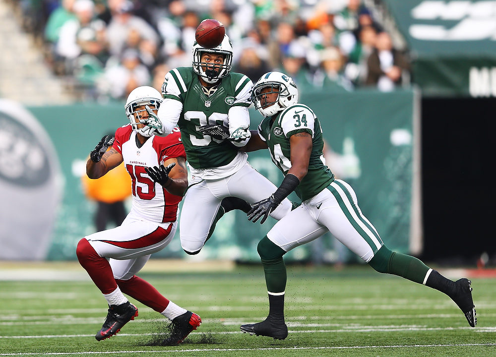 . LaRon Landry #30 of the New York Jets intercepts a pass thrown by  Ryan Lindley #14 of the Arizona Cardinals during their game at at MetLife Stadium on December 2, 2012 in East Rutherford, New Jersey.  (Photo by Al Bello/Getty Images)