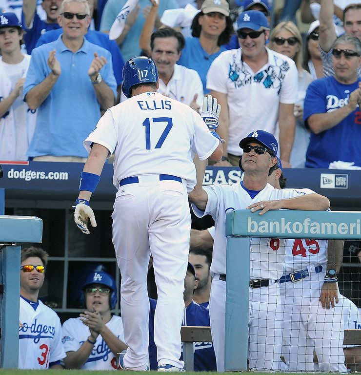 . The Dodgers\' A.J. Ellis enters the dugout after hitting a solo homer in the 7th against the Cardinals during game 5 of the NLCS at Dodger Stadium Wednesday, October 16, 2013. The Dodgers beat the Cardinals 6-4. (Photo by Hans Gutknecht/Los Angeles Daily News)