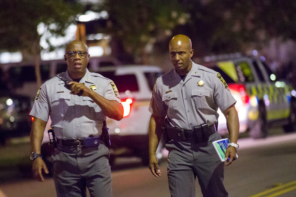 . Police investigators outside the historic Mother Emanuel African Methodist Episcopal Church where a gunman opened fire on a prayer meeting killing nine people on June 17, 2015 in Charleston, South Carolina.  Police believe the attack is a hate crime and are searching for a young white man believed to be the only shooter.  (Photo by  Richard Ellis/Getty Images)