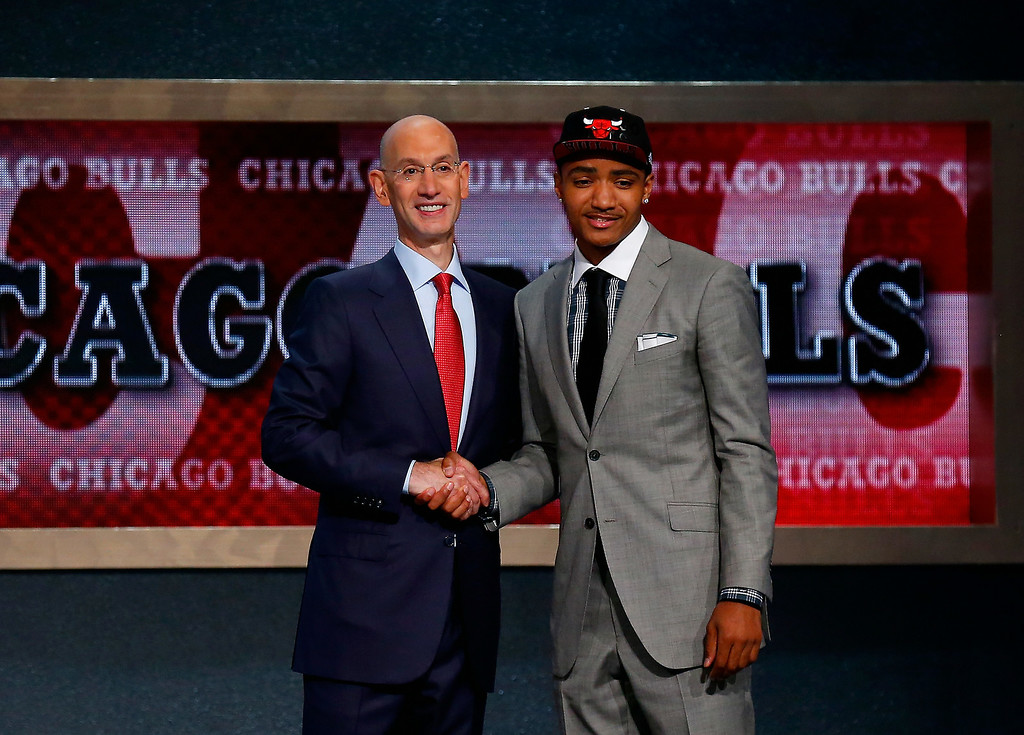 . Gary Harris of Michigan State (R) shakes hands with NBA Commissioner Adam Silver after being drafted with the #19 overall pick by the Chicago Bulls during the 2014 NBA Draft at Barclays Center on June 26, 2014 in the Brooklyn borough of New York City.  Harris was then traded to the Denver Nuggets.  (Photo by Mike Stobe/Getty Images)
