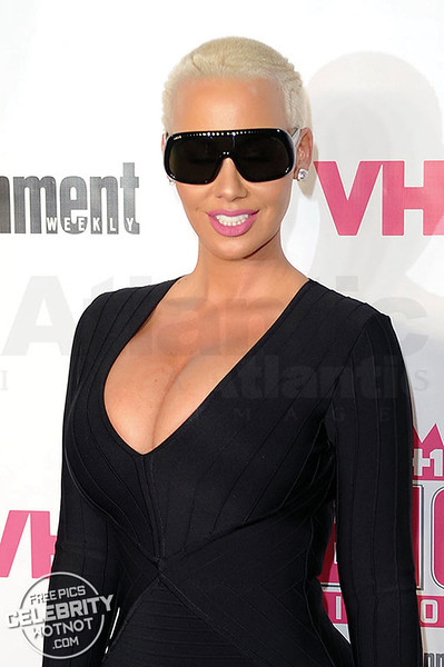 Amber Rose Fashions Tom Ford Shield Sunglasses in a LBD