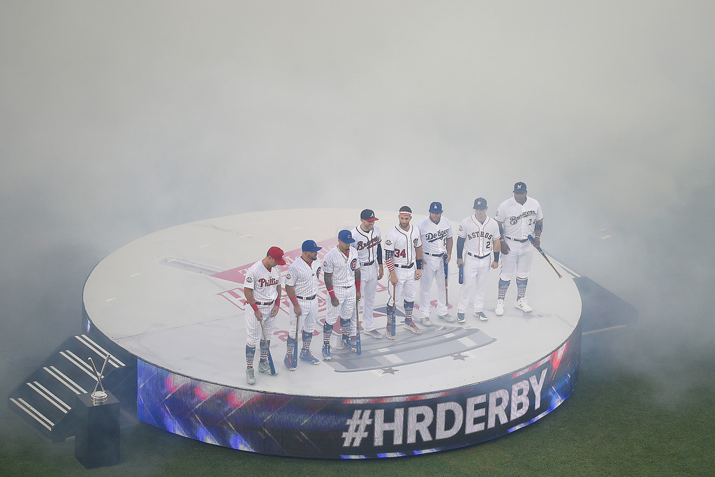 . MLB players line up before the MLB Home Run Derby, at Nationals Park, Monday, July 16, 2018 in Washington. The 89th MLB baseball All-Star Game will be played Tuesday. (AP Photo/Nick Wass)