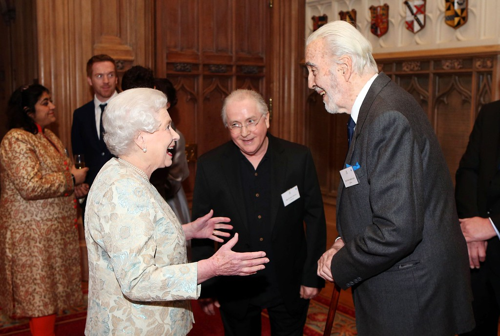 . In a file picture taken on April 4, 2013 Britain\'s Queen Elizabeth II (L) speaks with British actor Christopher Lee (R) at a reception celebrating the British Film Industry hosted by Queen Elizabeth and Prince Philip in Windsor Castle, Windsor.   AFP PHOTO / POOL / LUKE  Parsons/AFP/Getty Images