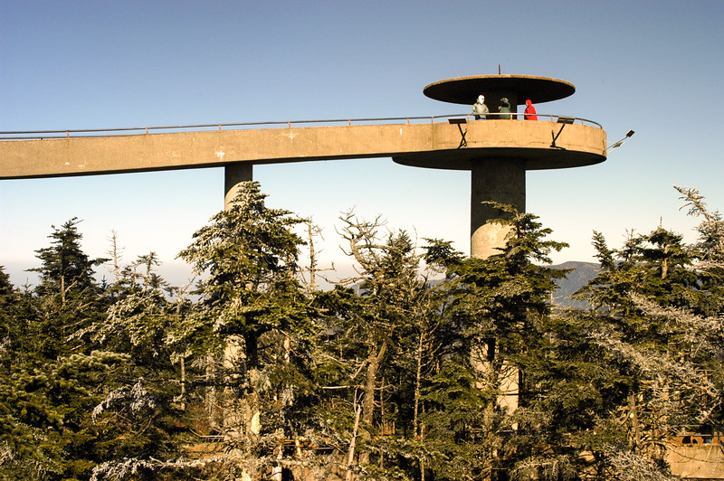 The paved walkway at Clingmans Dome stretches over trees and mountain scenery.