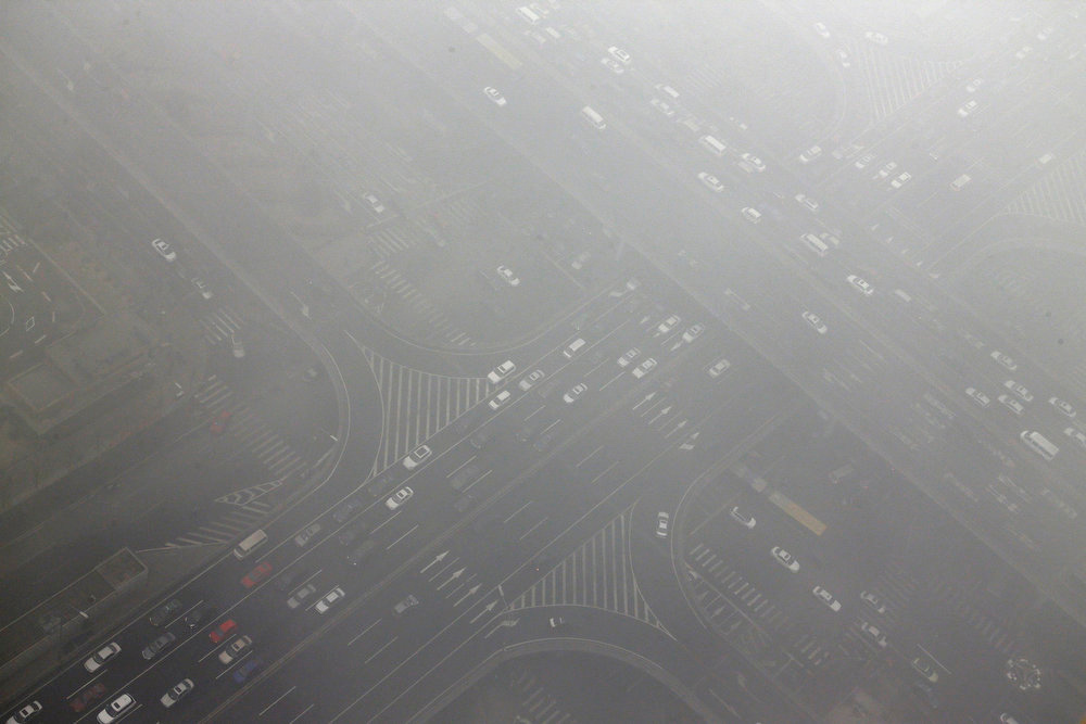 Description of . Cars drive through Guomao bridge on a heavy hazy day during winter in Beijing\'s central business district, January 30, 2013. Beijing temporarily shut down 103 heavily polluting factories and took 30 percent of government vehicles off roads to combat dangerously high air pollution, state media reported on Tuesday, but the capital\'s air remained hazardous despite the measures. REUTERS/Jason Lee