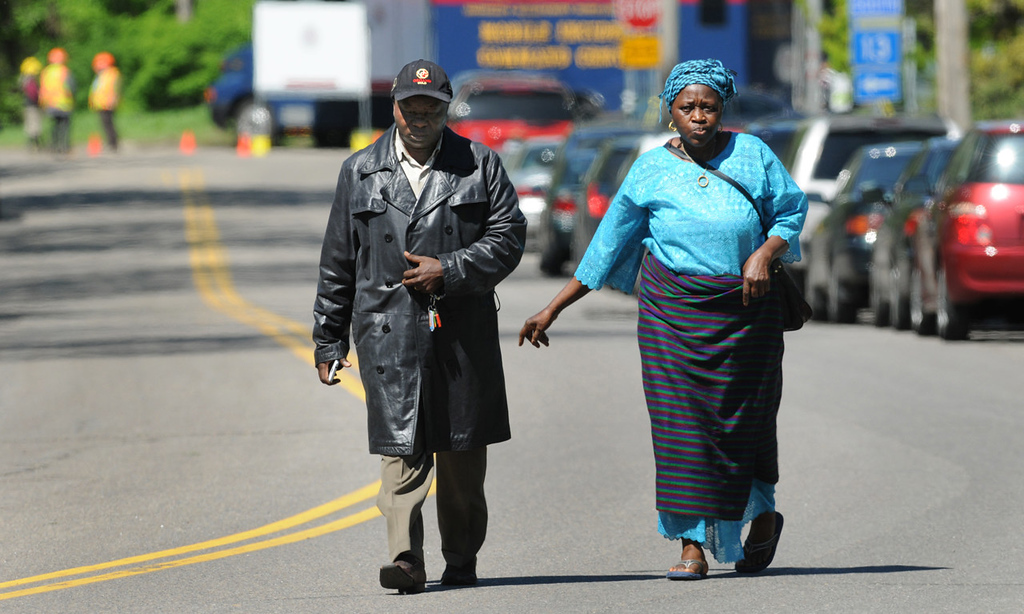. Frank Ngafua, left, an uncle of Zack Mohamed Fofana, walks down Annapolis Street with a relative near Lilydale Regional Park on Thursday morning. (Pioneer Press: Jean Pieri)