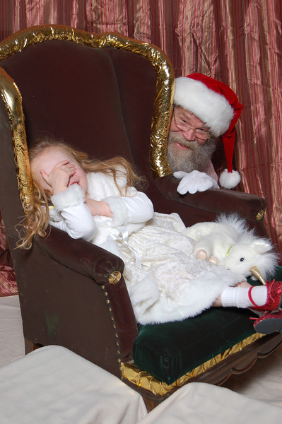 Kimber and Santa playing peek-a-boo.