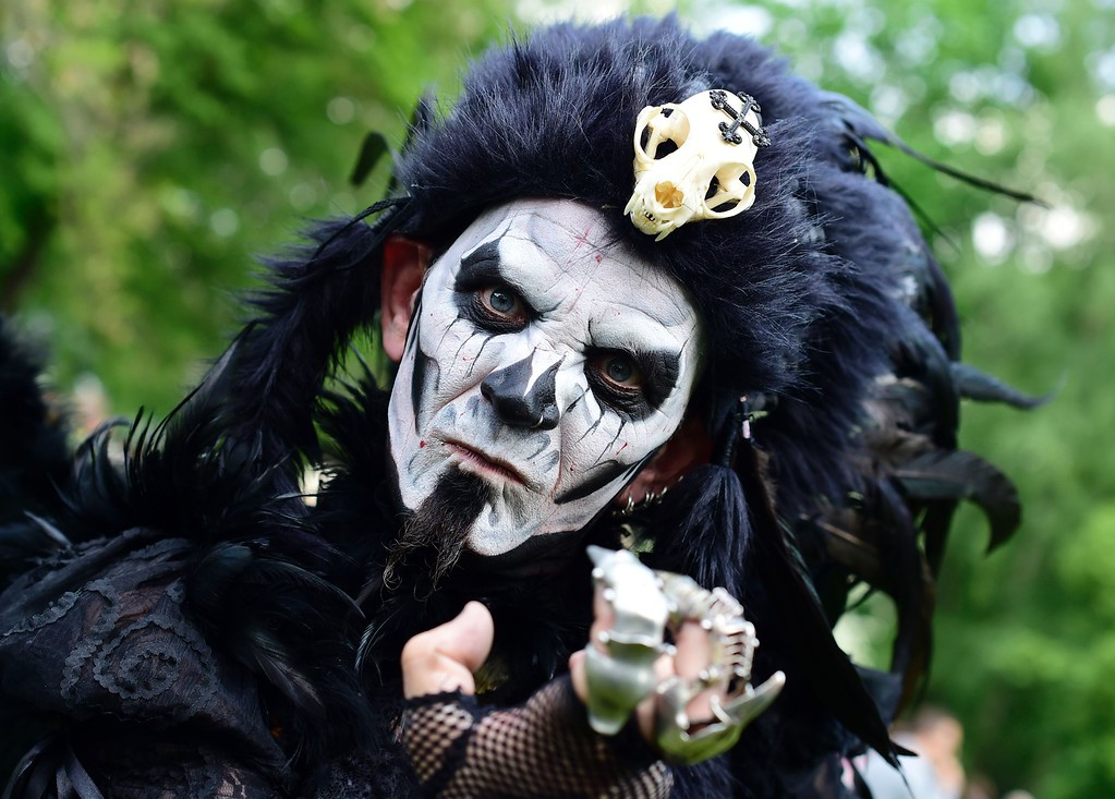 ". A dressed up man poses at a so-called ""Victorian Picnic\"" during the Wave-Gotik-Treffen (WGT) festival in Leipzig, eastern Germany, on May 13, 2016.   / AFP PHOTO / TOBIAS SCHWARZ/AFP/Getty Images"