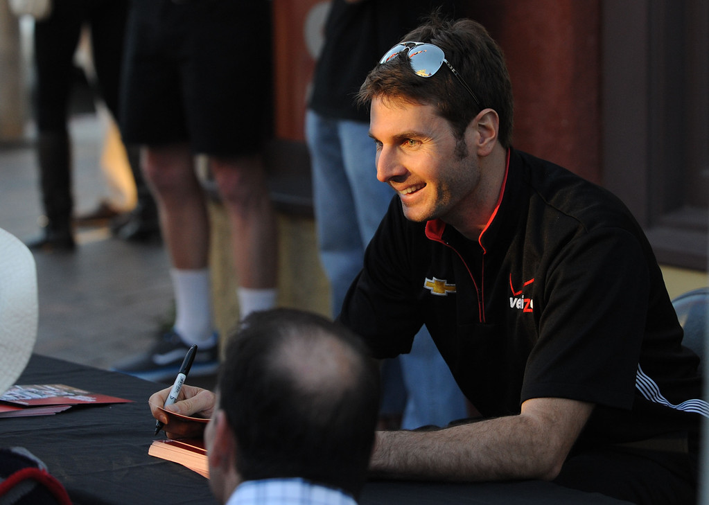 . Long Beach, Calif., -- 04-17-13-   Indy Car driver Will Power, winner of the 2012 Toyota Grand Prix of Long Beach, signs autographs in Belmont Shore during The Second Annual �Roar in the Shore,�  a free event,that featured race cars on display, driver autograph sessions, children�s face painting, balloon artists and live music from 6 to 8:30 p.m. along Second Street between Corona and Covina avenues.   Stephen Carr/  Los Angeles Newspaper Group
