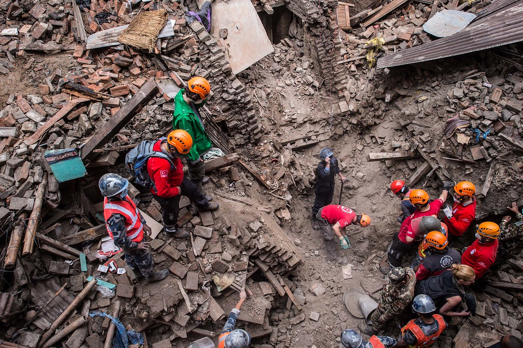 . Turkish Rescue Team members search for victims among debris of a house on April 29, 2015 in Bhaktapur, Nepal. A major 7.8 earthquake hit Kathmandu mid-day on Saturday, and was followed by multiple aftershocks that triggered avalanches on Mt. Everest that buried mountain climbers in their base camps. Many houses, buildings and temples in the capital were destroyed during the earthquake, leaving over 4600 dead and many more trapped under the debris as emergency rescue workers attempt to clear debris and find survivors. Regular aftershocks have hampered recovery missions as locals, officials and aid workers attempt to recover bodies from the rubble.  (Photo by David Ramos/Getty Images)