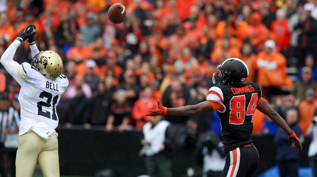 . Oregon State Beavers wide receiver Kevin Cummings (84) looks to a pass deflected by Colorado Buffaloes defensive back Jered Bell (21)in the first half at Reser Stadium in Corvallis Saturday.  Photo by Randy L. Rasmussen/The Oregonian