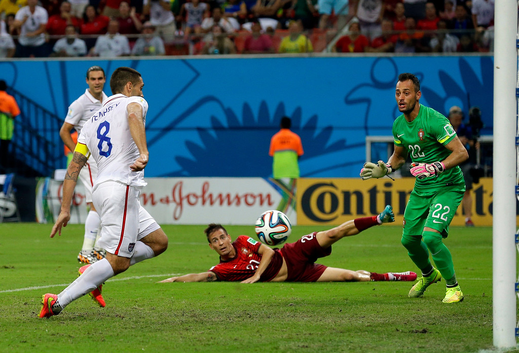 . Portugal\'s goalkeeper Beto watches as United States\' Clint Dempsey scores his side\'s second goal during the group G World Cup soccer match between the USA and Portugal at the Arena da Amazonia in Manaus, Brazil, Sunday, June 22, 2014. (AP Photo/Martin Mejia)