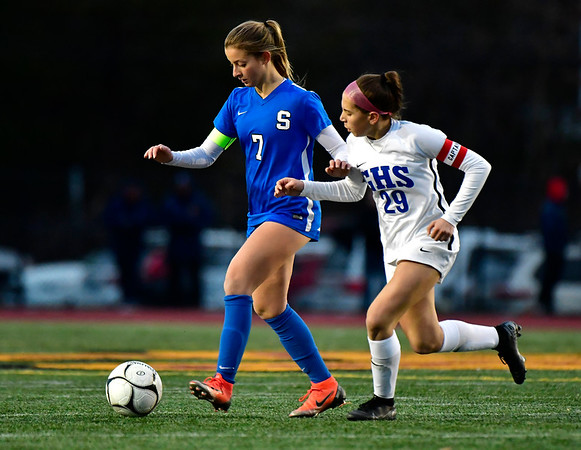 11/23/2019 Mike Orazzi | Staff Southington High School's Emma Panarella (7) and Glastonbury's Alexandra Bedard (29) during the Class LL Girls State Soccer Tournament at Veterans Stadium in New Britain Saturday evening. Glastonbury won 1-0.