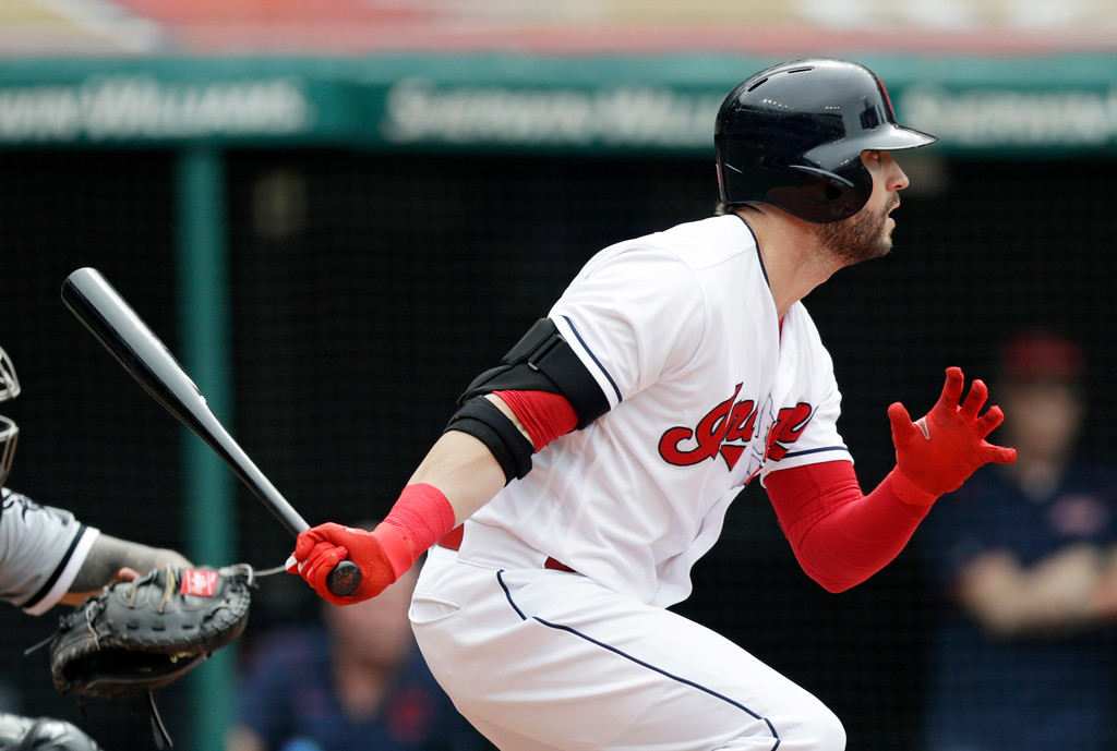 . Cleveland Indians\' Tyler Naquin hits against the Chicago White Sox in the eighth inning of a baseball game, Wednesday, June 20, 2018, in Cleveland. Naquin grounded out on the play. Yonder Alonso scored on the play. (AP Photo/Tony Dejak)