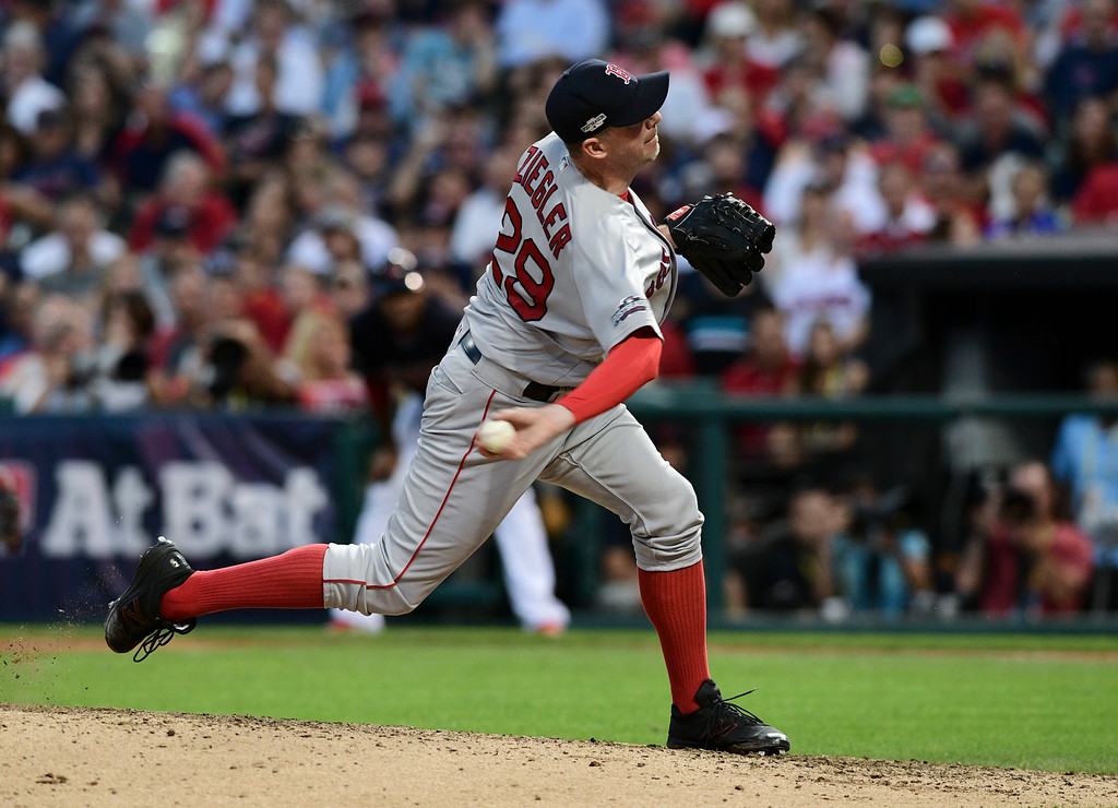 . Boston Red Sox relief pitcher Brad Ziegler throws to a Cleveland Indians batter during the sixth inning of Game 2 of a baseball American League Division Series, Friday, Oct. 7, 2016, in Cleveland. (AP Photo/David Dermer)
