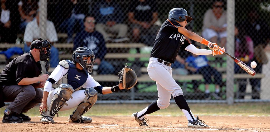 . La Puente Tizoc Monarrez in the second inning of a prep baseball game against Duarte at Duarte High School on Thursday, April 25, 2012 in Duarte, Calif. Duarte won 4-3.    (Keith Birmingham/Pasadena Star-News)