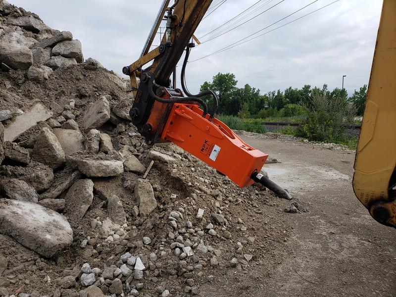 NPK PH3 hydraulic hammer in enclosed bracket on Cat 446B backhoe - dust suppression system - Carr Bros 8-7-18 (1).jpg