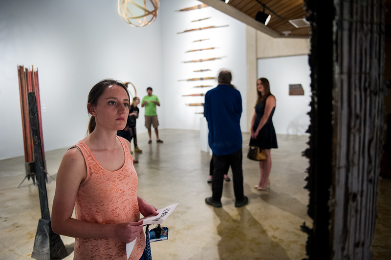 Amber Hullum observes the works of art in the Weil Gallery