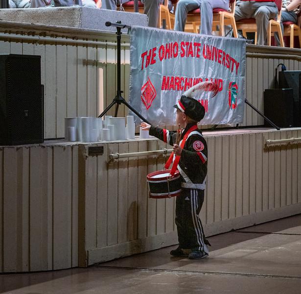 Future percussionist choosing a shaker