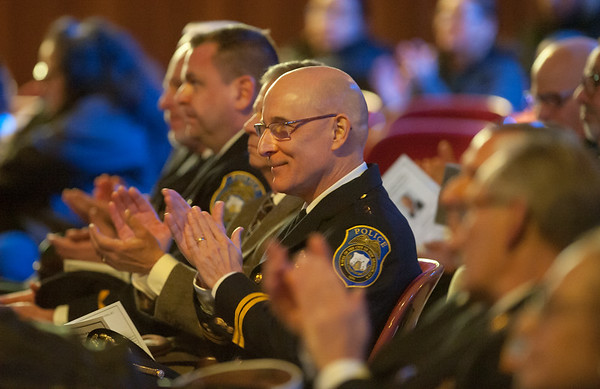 Wesley Bunnell | Staff Police Chief James Wardwell and other city officials applaud during a Martin Luther King Jr. Day ceremony at Trinity-on-Main in January.
